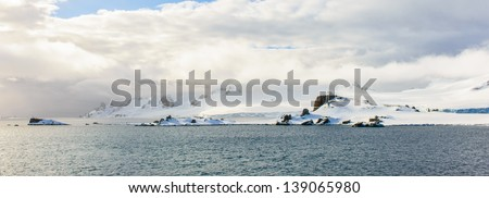 Clouds cover the snow rock of South Shetland Islands