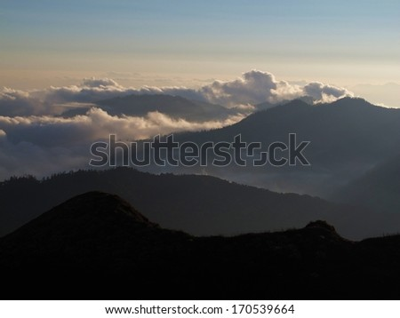 Clouds creeping over a mountain ridge, Annapurna Conservation Area, Nepal