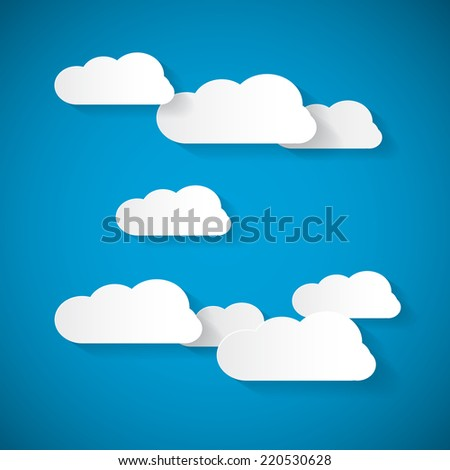 Clouds Cut From Paper on Blue Sky Background