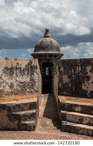 clouds form above Watch Tower  at El Morrow fort in San Juan, Puerto Rico.
