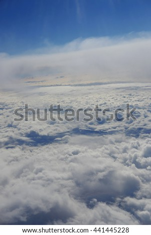Clouds from an aeroplane window - stock photo