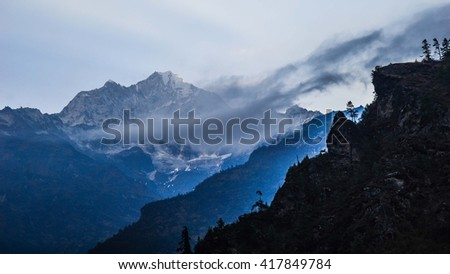 Clouds hanging over the Himalayan mountains, Nepal - stock photo