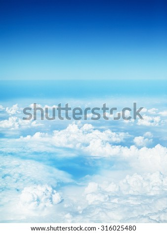 clouds in a blue sky, view from airplane - stock photo