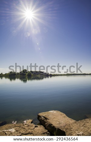 Clouds in summer heavenly sky over lake - stock photo