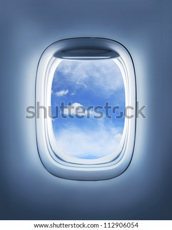 clouds in the aircraft's porthole - stock photo