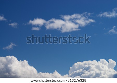 Clouds in the blue sky and free space for typing text