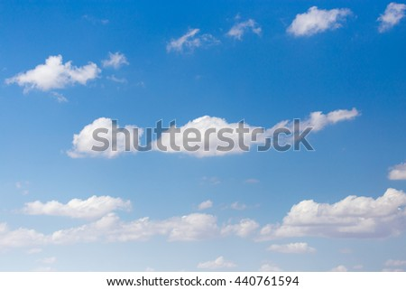clouds in the blue sky as background - stock photo