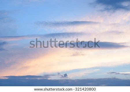 Clouds in the blue sky at dusk