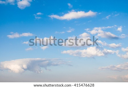 Clouds in the blue sky with atmospheric haze