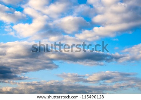 Clouds in the blue sunset sky - stock photo
