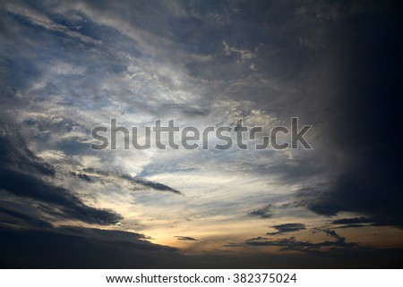 Clouds in the sky at dusk. - stock photo