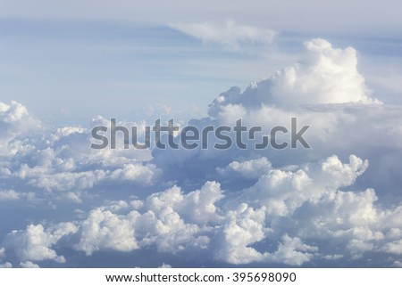 Clouds in the sky on plane view background - stock photo