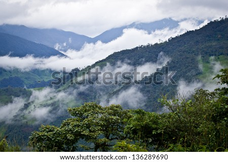 Clouds moving through the Andes Mountains of Ecuador - stock photo