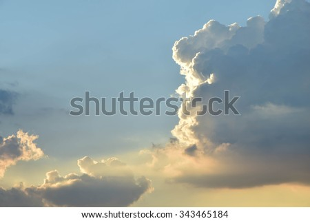 Clouds of black gold on a blue sky background.