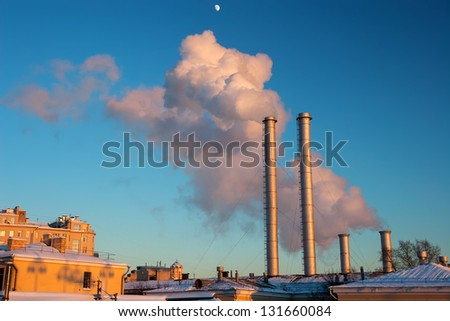 Clouds of steam from a power plant in the sunset, Moscow, Russia - stock photo
