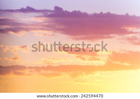 clouds on a background of orange and purple sunset  - stock photo