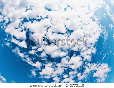 clouds on a sky in a clear day, wide angle view - stock photo