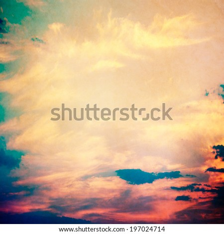 clouds on a textured vintage paper background, with grunge stains - stock photo