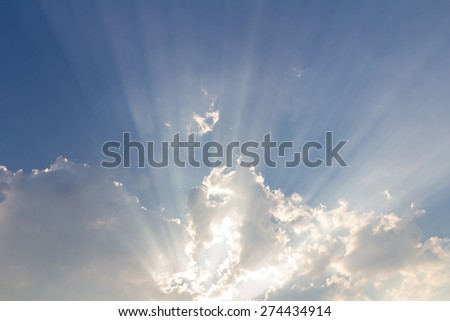 Clouds on blue sky background and sun ray - stock photo