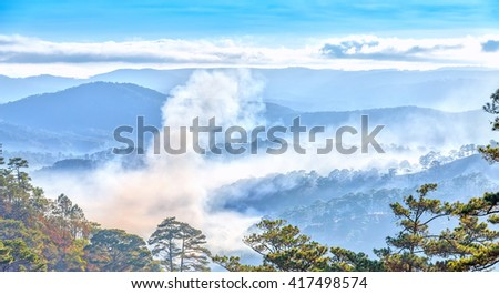 Clouds on hill plateau with clouds threaded through like white velvet carpet covered pine forests, mountainous part sunshine yellow make paintings that adorn countryside