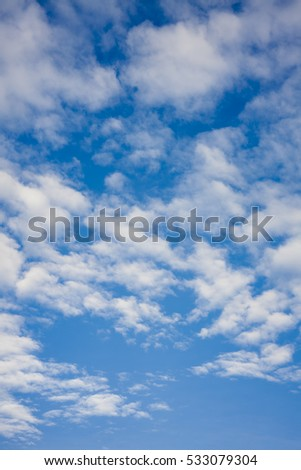 clouds on the blue sky, vertical photo