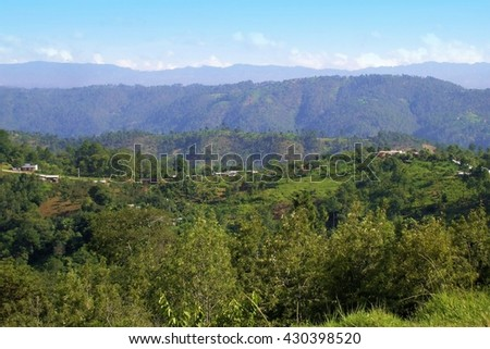 Clouds on the Horizon of a Blue Sky and Lush Vegetation in a Valley