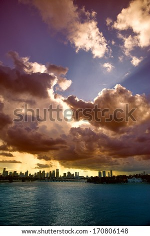 Clouds over a city at dusk, MacArthur Causeway Bridge, Miami, Florida, USA - stock photo