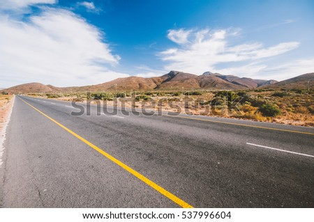 clouds over a road stretching into the distance in South Africa, Africa