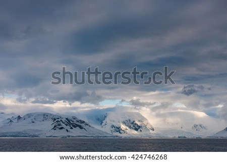 Clouds over Antarctic peninsula during summer - stock photo