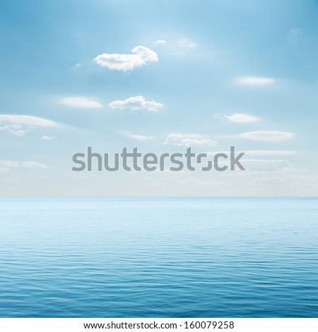 clouds over blue sea - stock photo