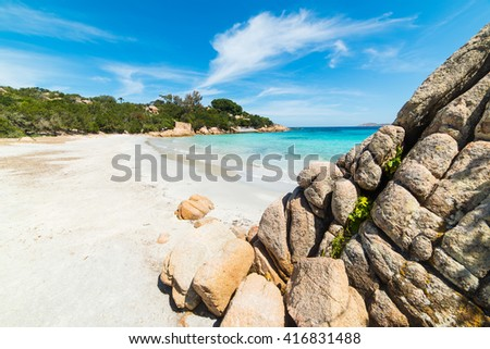 clouds over Capriccioli beach in Costa Smeralda, Italy - stock photo