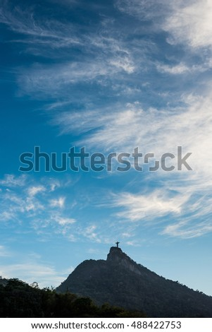 Clouds over Christ the Redeemer and Corcovado Mountain before sunset in Rio de Janeiro, Brazil