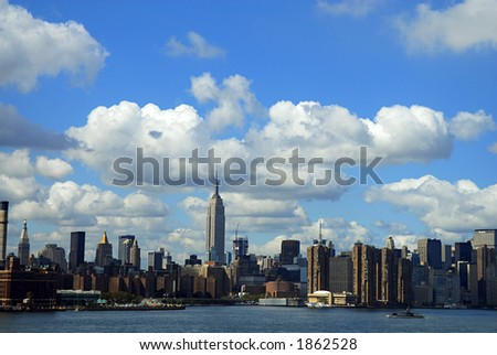 clouds over nyc skyline - stock photo