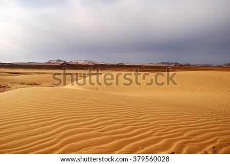 Clouds over sahara desert - stock photo
