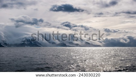 clouds over south orkney islands  - stock photo