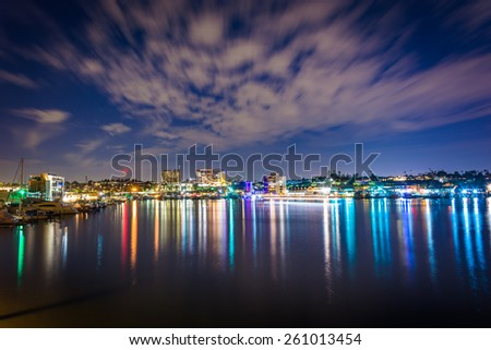 Clouds over the harbor at night, seen from the Via Lido Bridge, in Newport Beach, California. - stock photo