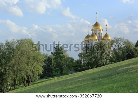 """Clouds over the orthodox temple of """"All Saints Church"""" in Volgograd, Russia, - stock photo"""