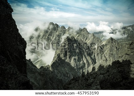 Clouds over valley in high mountains