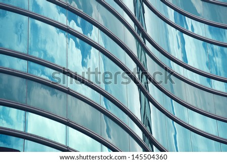 Clouds reflected in modern building  windows - stock photo