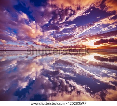 clouds reflected in the water at sunset, Sardinia