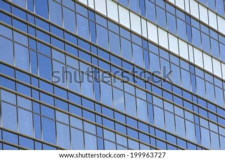 Clouds reflected in windows in the office building