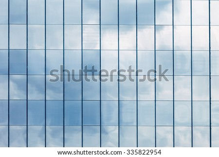 Clouds Reflected in Windows of Modern Office Building. - stock photo