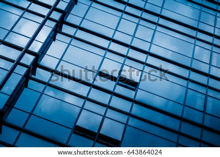 Clouds reflected in windows of modern office building