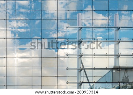 Clouds Reflection On Modern Office Building Windows - stock photo