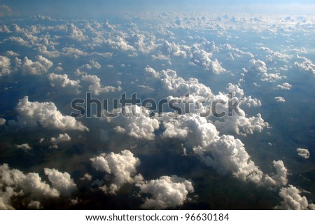 Clouds seen from above the European sky. - stock photo