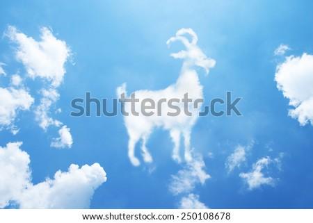 Clouds shaped like a goat. - stock photo