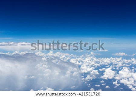 Clouds, sky as seen through window of an aircraft - stock photo