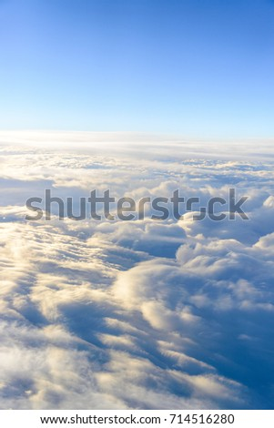 clouds sky skyscape. view from the window of an airplane flying in the clouds, top view clouds like  the sea of clouds sky background