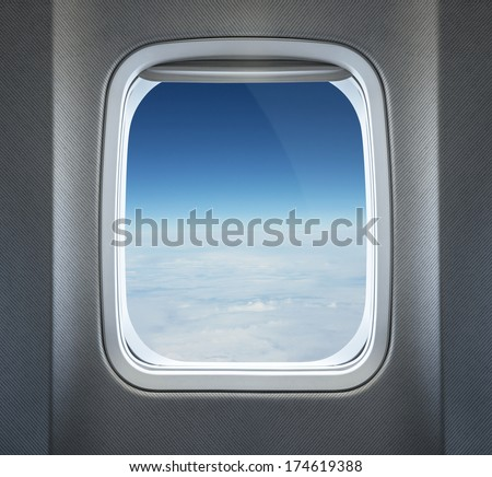 Clouds through the airplane window - stock photo