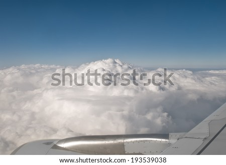 clouds viewed from a big jet plane - stock photo